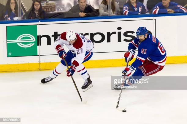 New York Rangers left wing Rick Nash steals the puck from Montreal Canadiens center Alex Galchenyuk during the third period of game 3 of the first...