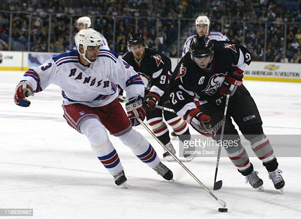 New York Rangers' Michal Rozsival and Buffalo Sabres' Thomas Vanek during a game against the Buffalo Sabres at the HSBC Arena in Buffalo NY November...