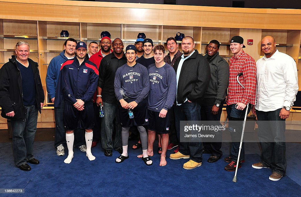 New York Rangers players pose with New York Giants players in the Rangers locker room after the Tampa Bay Lightning vs the New York Rangers game at Madison Square Garden on February 9, 2012 in New York City.
