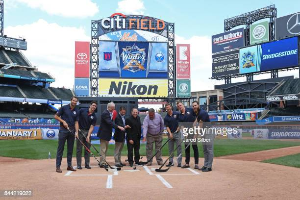 New York Rangers players Rick Nash and Ryan McDonagh along with Buffalo Sabres players Jason Pominville Jack Eichel and Ryan O'Reilly pose for a...