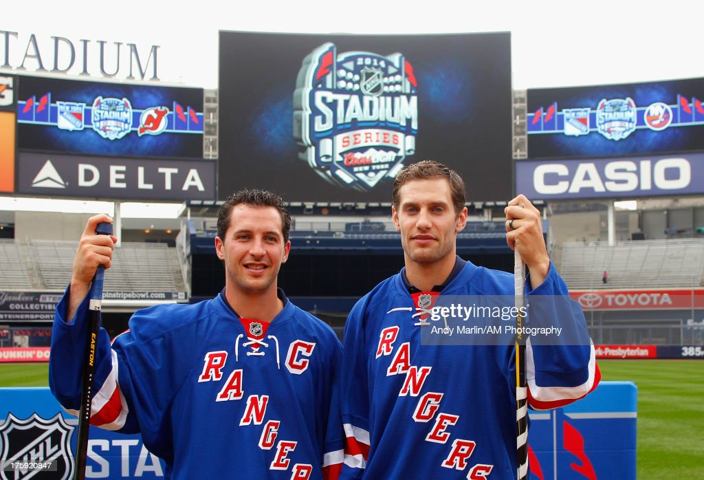 New York Rangers players <a gi-track='captionPersonalityLinkClicked' href=/galleries/search?phrase=Ryan+Callahan&family=editorial&specificpeople=809690 ng-click='$event.stopPropagation()'>Ryan Callahan</a> (L) and Dan Girardi pose for a photo during the 2014 NHL Stadium Series Media Availabilty at Yankee Stadium on August 8, 2013 in New York City.