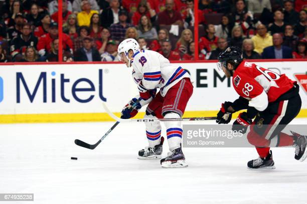 New York Rangers Right Wing Jesper Fast goes in for scoring chance with Ottawa Senators Left Wing Mike Hoffman in close pursuit during the first...