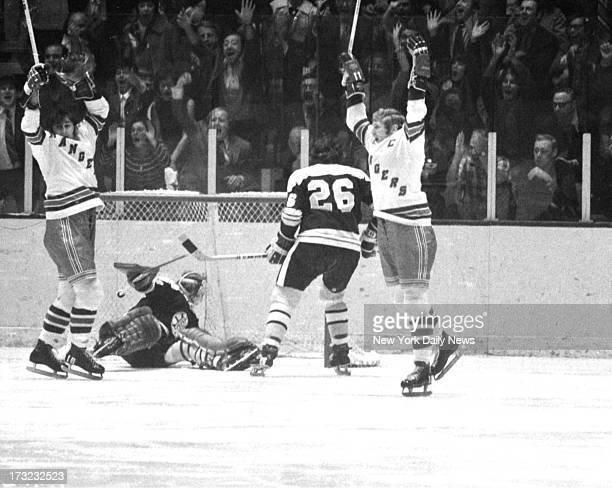 New York Rangers vs Boston Bruins Garden partisans and Rangers Walt Tkaczuk and Vic Hadfield exult together as Brad Park scores first goal of the...