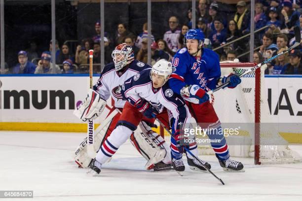 New York Rangers Winger JT Miller and Columbus Blue Jackets Defenseman Jack Johnson lean on each other in front of Columbus Blue Jackets Goalie...