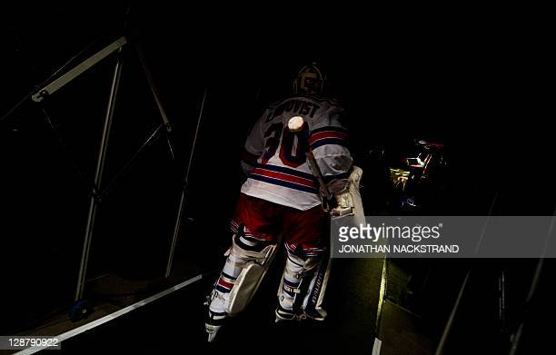 New York Rangers's goalie Henrik Lundqvist leaves the rink after a warmup at the beginning of the ice hockey NHL season game against Anaheim Ducks at...