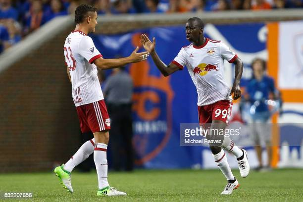 New York Red Bull forward Bradley WrightPhillips celebrates with teammates after scoring a goal against FC Cincinnati in the second half of the...