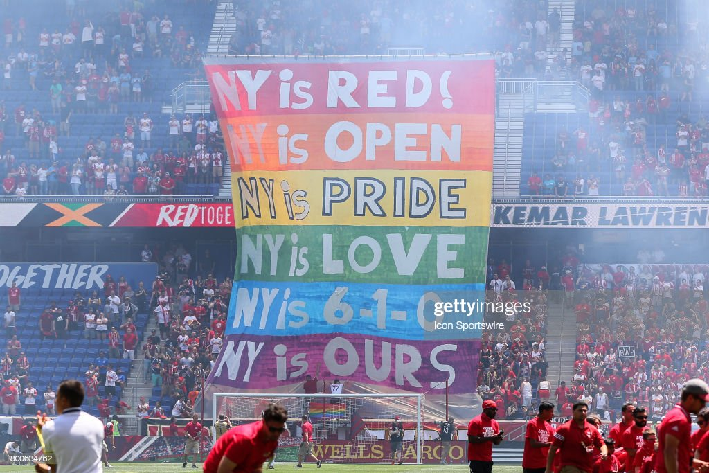New York Red Bulls fans raise a rainbow Pride banner prior to the first half of the Major League Soccer game between the New York Red Bulls and New York City FC on June 24, 2017, at Red Bull Arena in Harrison, NJ.