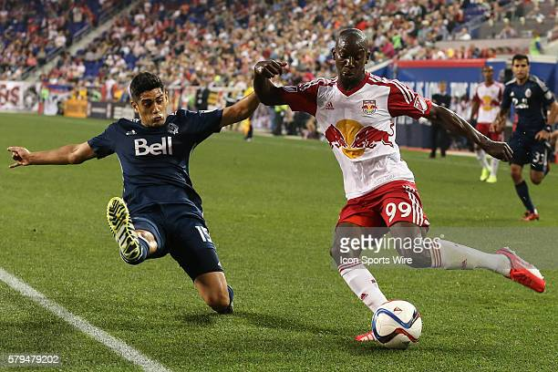 New York Red Bulls forward Bradley WrightPhillips battles Vancouver FC midfielder Matias Laba during the second half of the game between the New York...