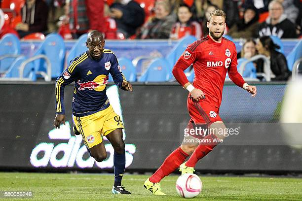 New York Red Bulls forward Bradley WrightPhillips chases after the ball against Toronto FC defender Josh Williams at BMO Field in Toronto Ontario CAN