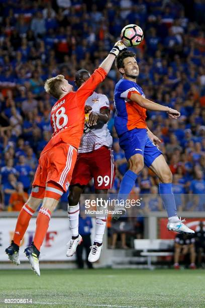 New York Red Bulls goalie Ryan Meara punches away a corner kick from FC Cincinnati forward Andrew Wiedeman during the semifinal match of the 2017...