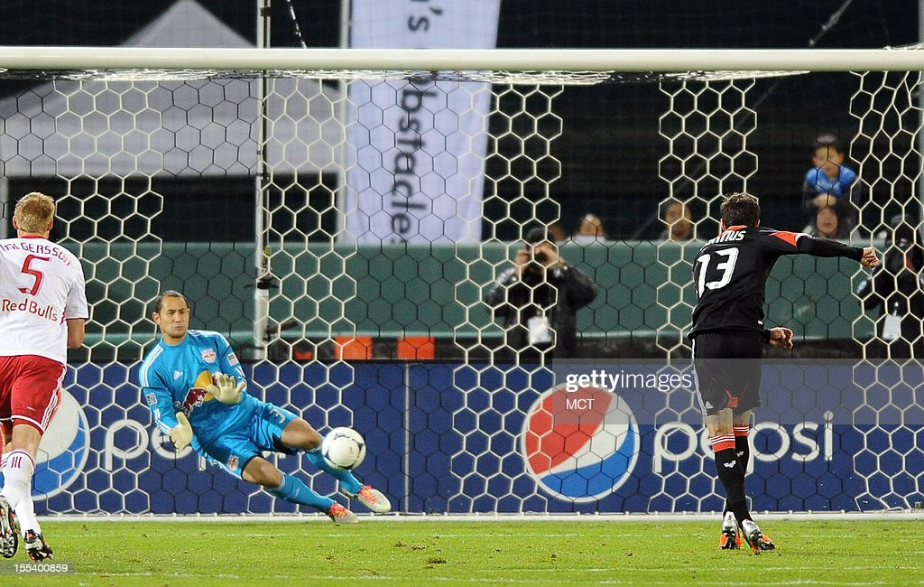 New York Red Bulls goalkeeper Luis Robles makes a save on a penalty kick by D.C. United midfielder Chris Pontius (13) during first-half action in an MLS Eastern Conference semifinal at RFK Stadium in Washington, D.C., Saturday, November 3, 2012.