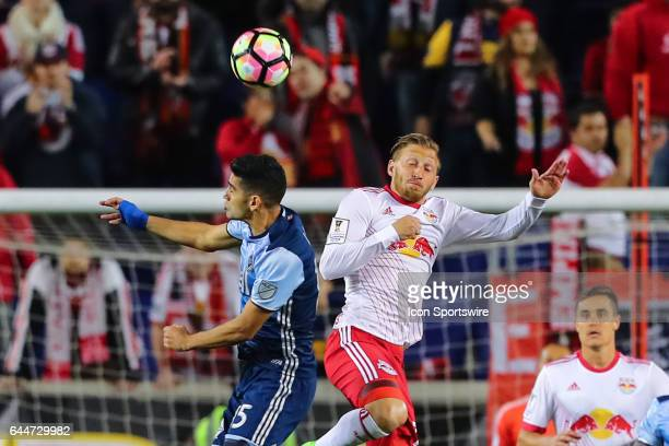 New York Red Bulls midfielder Daniel Royer heads the ball against Vancouver Whitecaps midfielder Matias Laba during the first half of the CONCACAF...