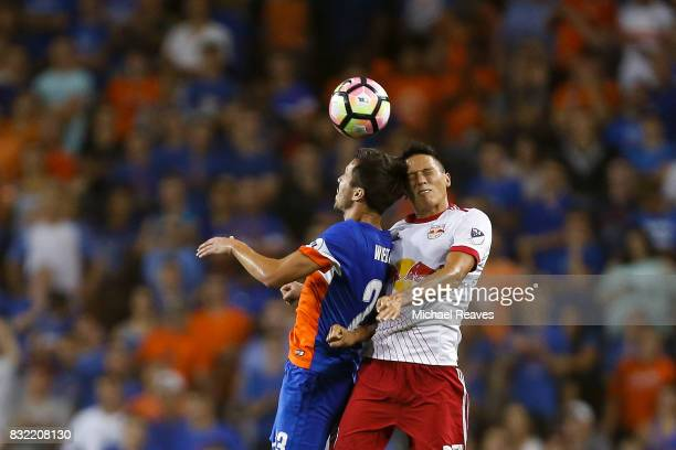 New York Red Bulls midfielder Sean Davis fights for a header with FC Cincinnati forward Andrew Wiedeman during the semifinal match of the 2017 Lamar...