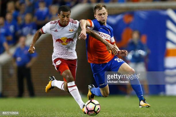 New York Red Bulls midfielder Tyler Adams battles FC Cincinnati midfielder Jimmy McLaughlin for possession during the semifinal match of the 2017...