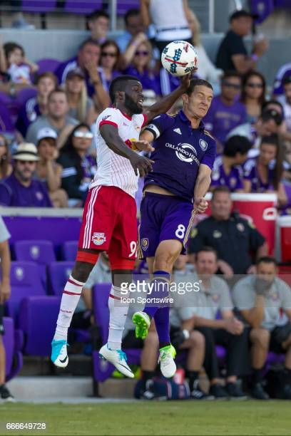 New York red bulls victor Giro and Orlando City SC forward Will Johnson go up for a headderDuring the MLS soccer match between the Orlando City FC vs...