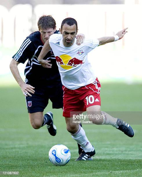New York Red Bulls' Youri Djorkaeff is held back by DC United's Brandon Prideaux at RFK Stadium in Washington DC on Sunday April 2 2006 The Red Bulls...