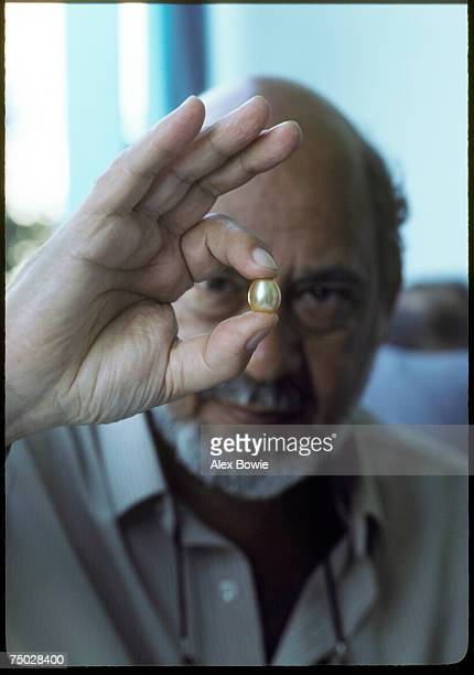 New York retail jewellery designer Arthur King examines a large golden pearl at the Burmese governmentrun auction known as The Burmese Gems Jade and...