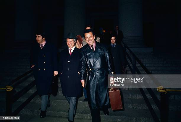 Ronald E Galella free lance photographer involved in countersuit with Mrs Jacqueline Onassis leaves Federal Building with gaily smiling entourage...