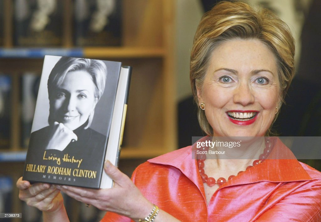 New York Senator and former First Lady Hillary Rodham Clinton holds a copy of her autobiography, 'Living History' on July 5, 2003 in Oxford, England. Clinton reveals her presidential ambitions and her thoughts on Monica Lewinsky in the book.