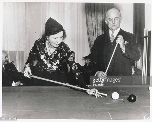 Society Woman Shows Proficiency With Cue Mrs F Bartholomay Jelke society woman shows her skill with the cue in a billiard match as her opponent Conde...