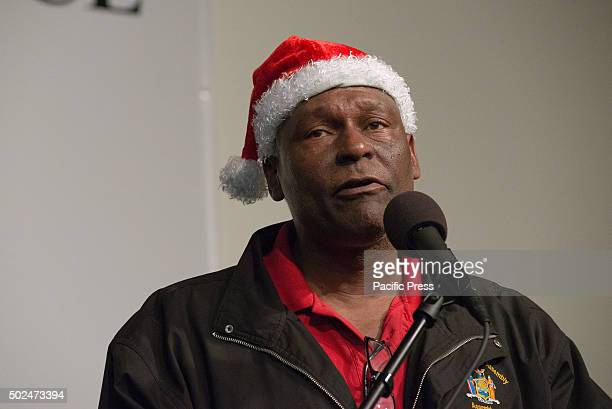 New York State Assemblyman Keith Wright speaks to the attendees of the NAN holiday meal New York City Mayor Bill de Blasio and his daughter Chiara...