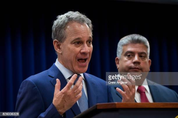 New York State Attorney General Eric Schneiderman speaks as Acting Brooklyn Attorney General Eric Gonzalez looks on during a press conference to call...