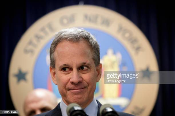 New York state Attorney General Eric Schneiderman takes questions during a news conference to announce the take down of a large organized crime ring...