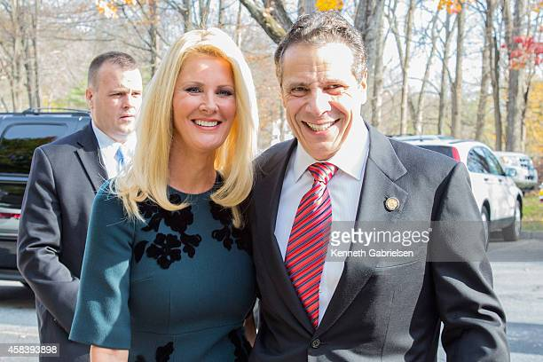 New York State Governor Andrew Cuomo and his girlfriend television personality Sandra Lee vote during the 2014 general election at the Presbyterian...