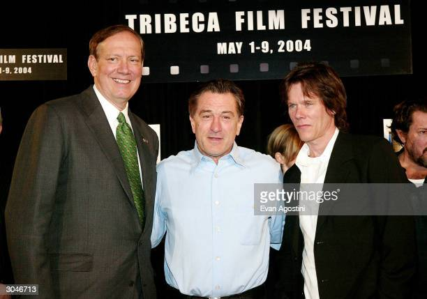 New York State Governor George Pataki Tribeca Film Festival cofounder Robert De Niro and actor Kevin Bacon pose together at the 2004 Tribeca Film...