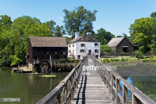 USA, New York State, Hudson Valley, Philipsburg Manor, Sleepy Hollow, historical footbridge and buildings