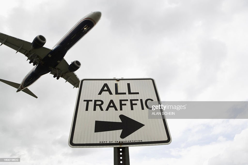 USA, New York State, New York City, Airplane flying above road signs