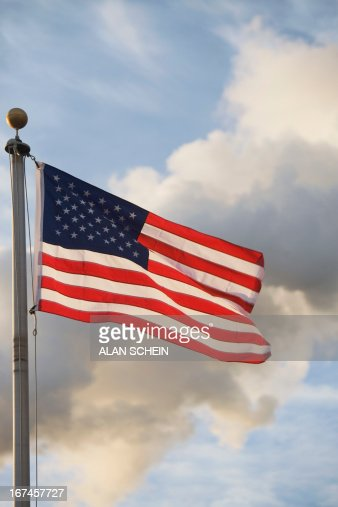 USA, New York State, New York City, American flag in front of smoke stacks  : Stock Photo