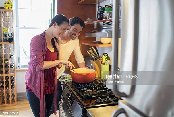 USA, New York State, New York City, Brooklyn, Happy couple preparing dinner