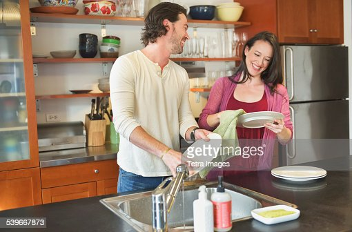 USA, New York State, New York City, Brooklyn, Happy couple washing dishes
