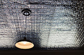 USA, New York State, New York City, Brooklyn, Pendant lamp on tiled ceiling