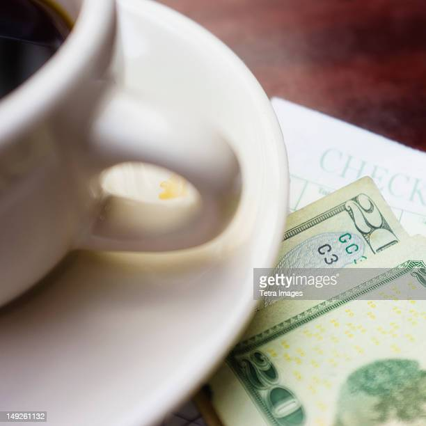 USA, New York State, New York City, Coffe and banknote on table