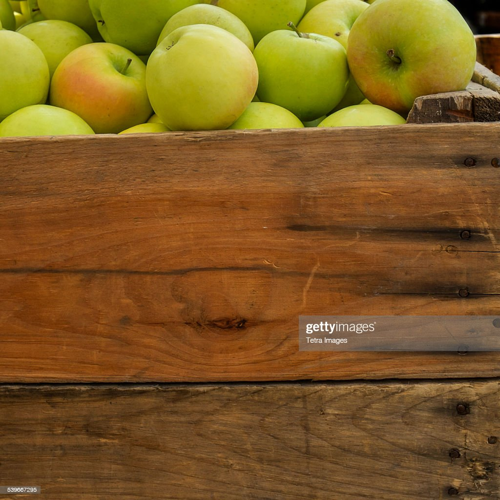 USA, New York State, New York City, Green apples in crate