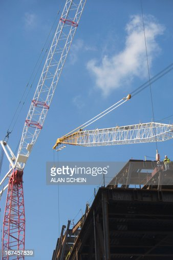 USA, New York State, New York City, Low angle view of crane and construction frame : Stock Photo