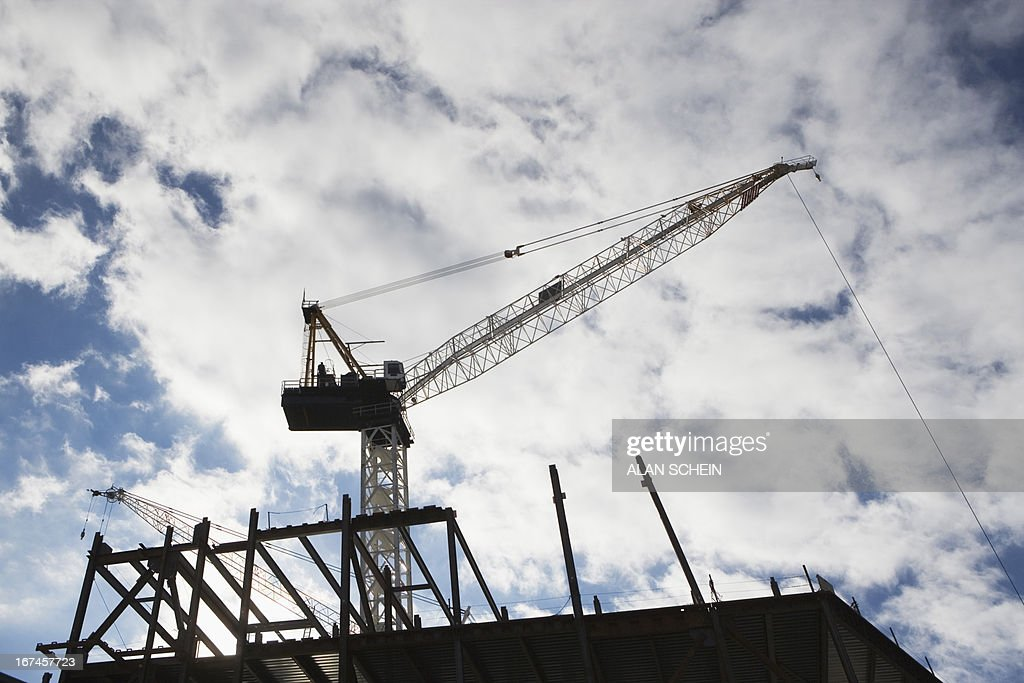 USA, New York State, New York City, Low angle view of crane at building site : Stock Photo