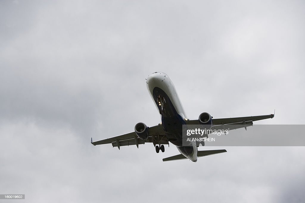 USA, New York State, New York City, Low angle view of flying airplane