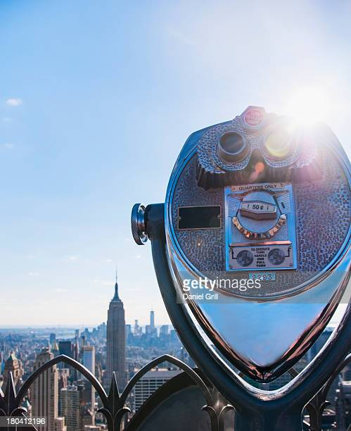 USA, New York State, New York City, Manhattan, Coin operated binoculars with Empire State Building in background