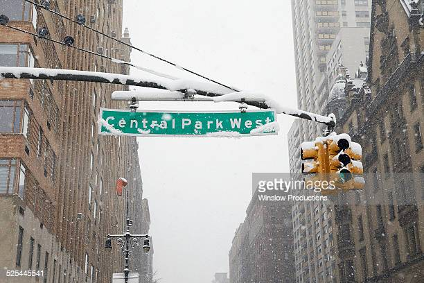 USA, New York State, New York City, Manhattan, Directional sign with Dakota Apartment Building in background
