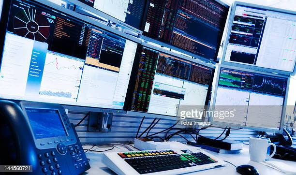 USA, New York State, New York City, Monitors above trading desk