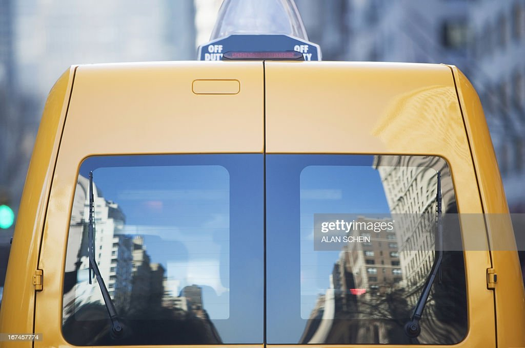 USA, New York State, New York City, Reflection in rear window of yellow taxi : Stock Photo
