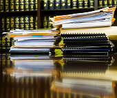 USA, New York State, New York City, Stack of books and files on table