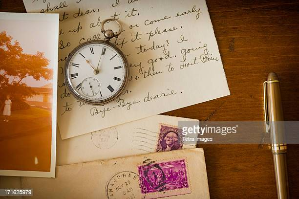 USA, New York State, New York City, Still life with pocket watch, old letter and photograph