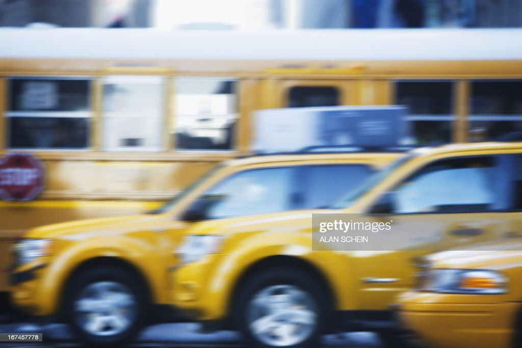 USA, New York State, New York City, Taxicabs and yellow bus : Stock Photo