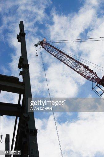 USA, New York State, New York City, Upward view of crane and construction : Stock Photo