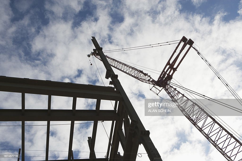 USA, New York State, New York City, Upward view of crane and construction : Stock Photo