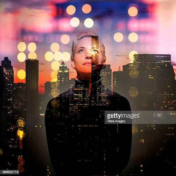 New York State, New York City, Young woman looking up at night
